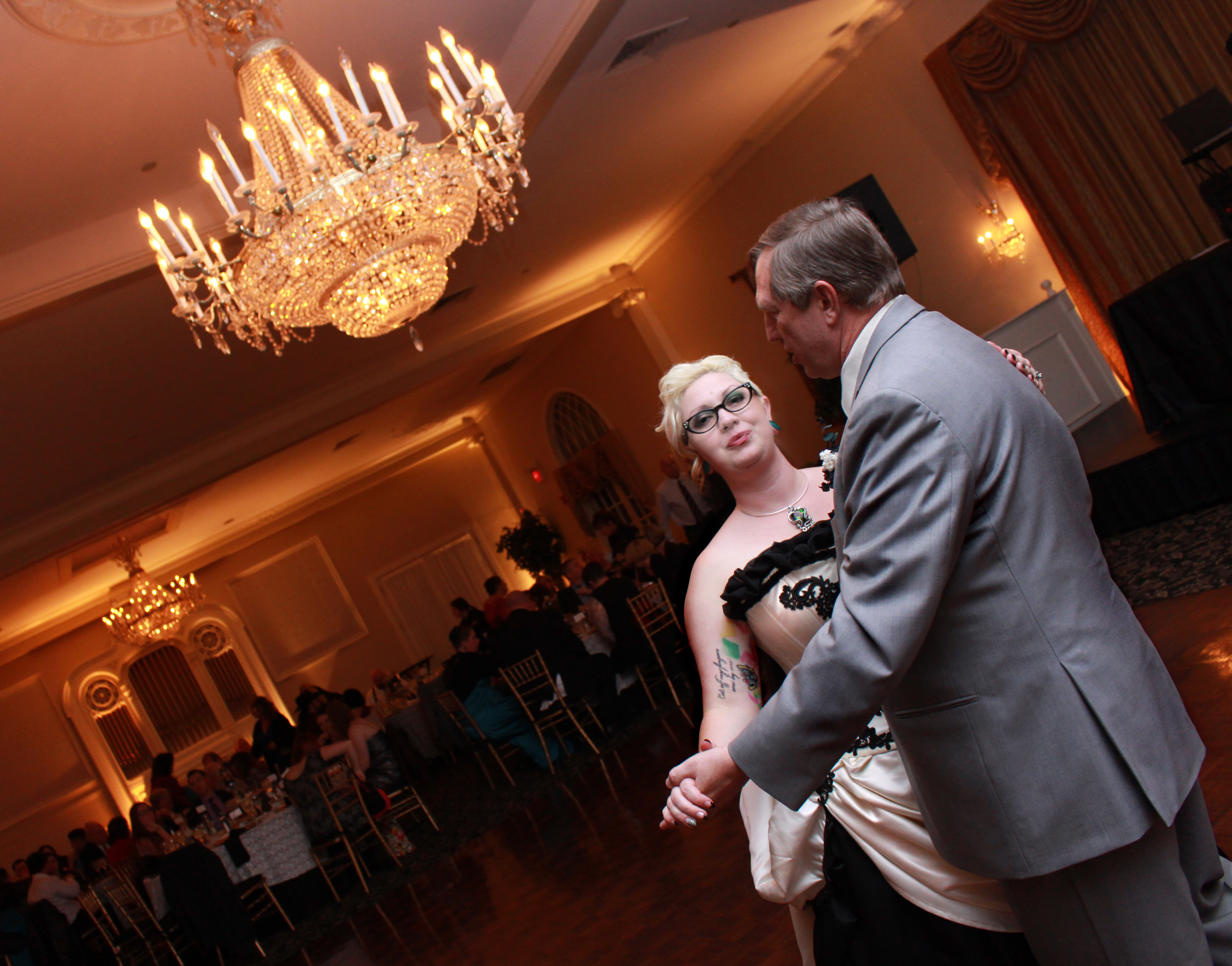 bride dancing with dad