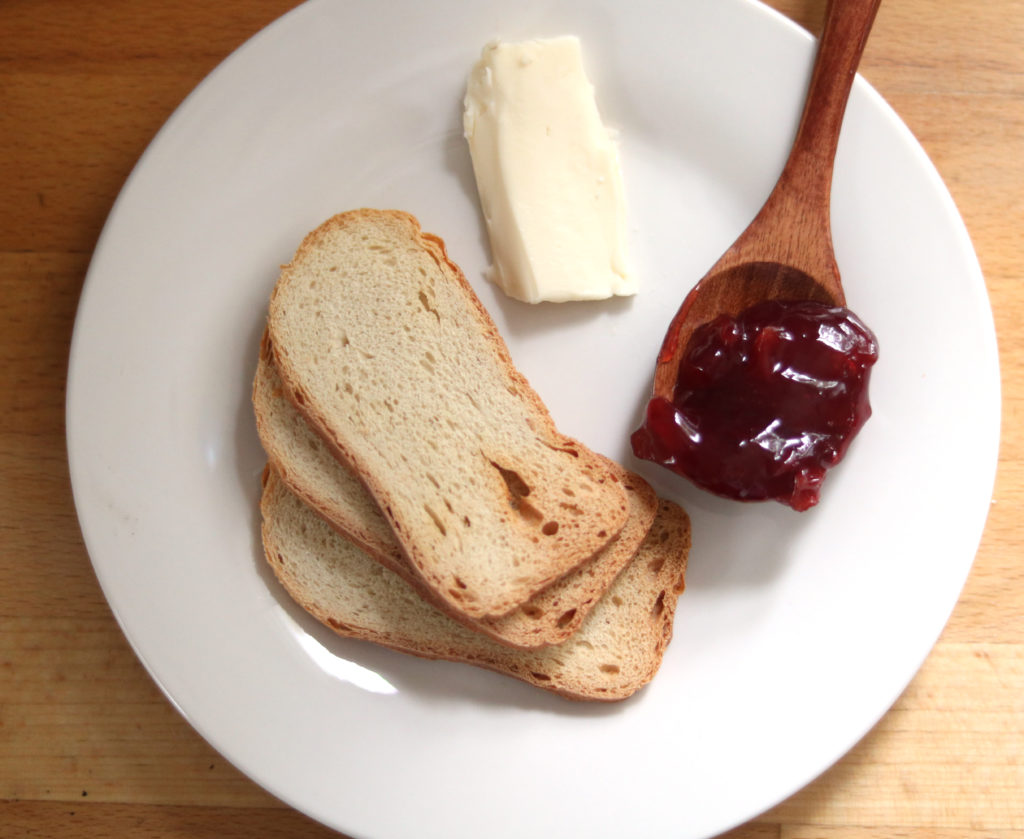 Brie Cheese with Cherry Perserves and Sliced Baguette