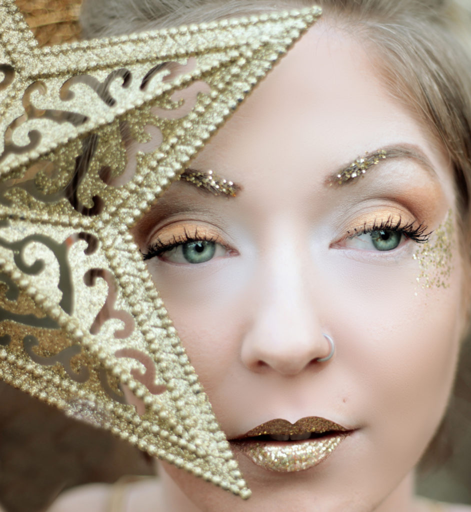 Glitter makeup fall trend.