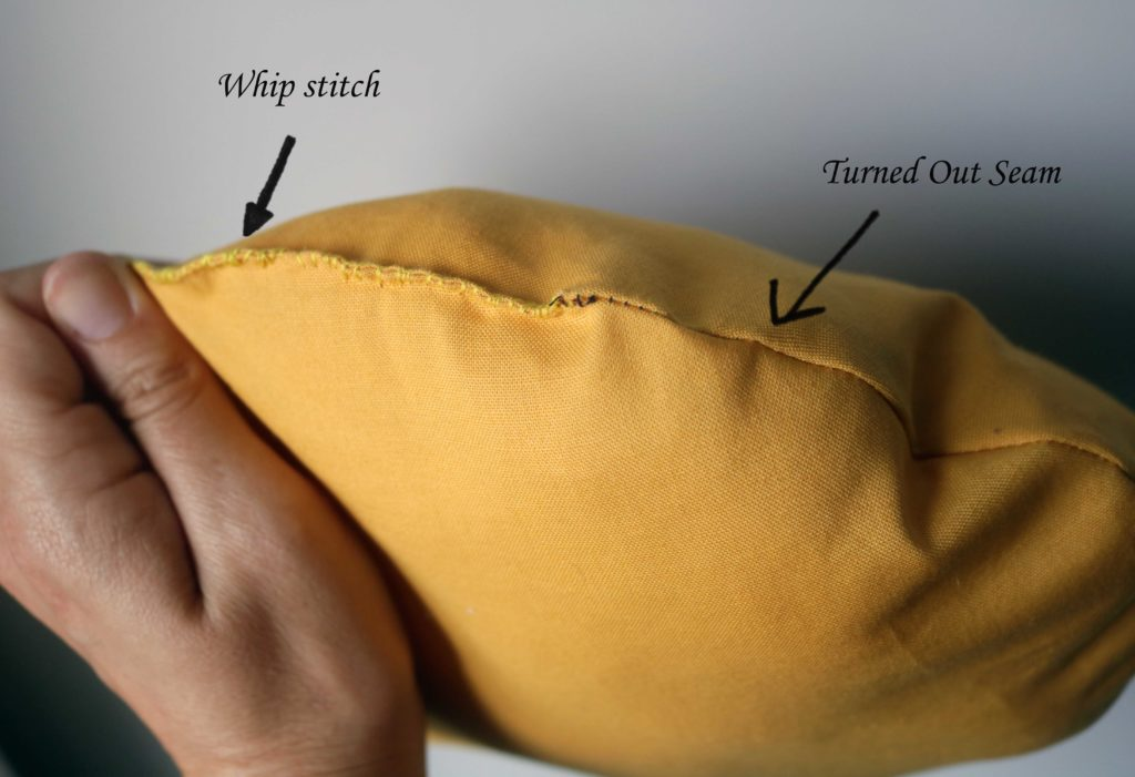 Whip stitch on a turned out seam.