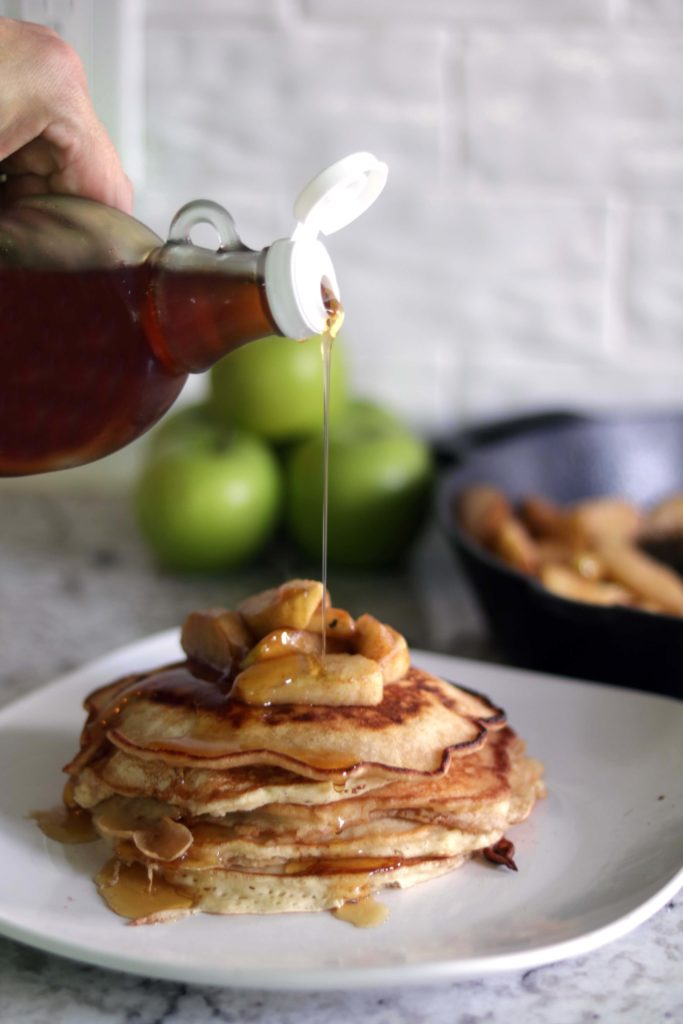 Spicy gingerbread pancakes with a warm maple syrup drizzle.