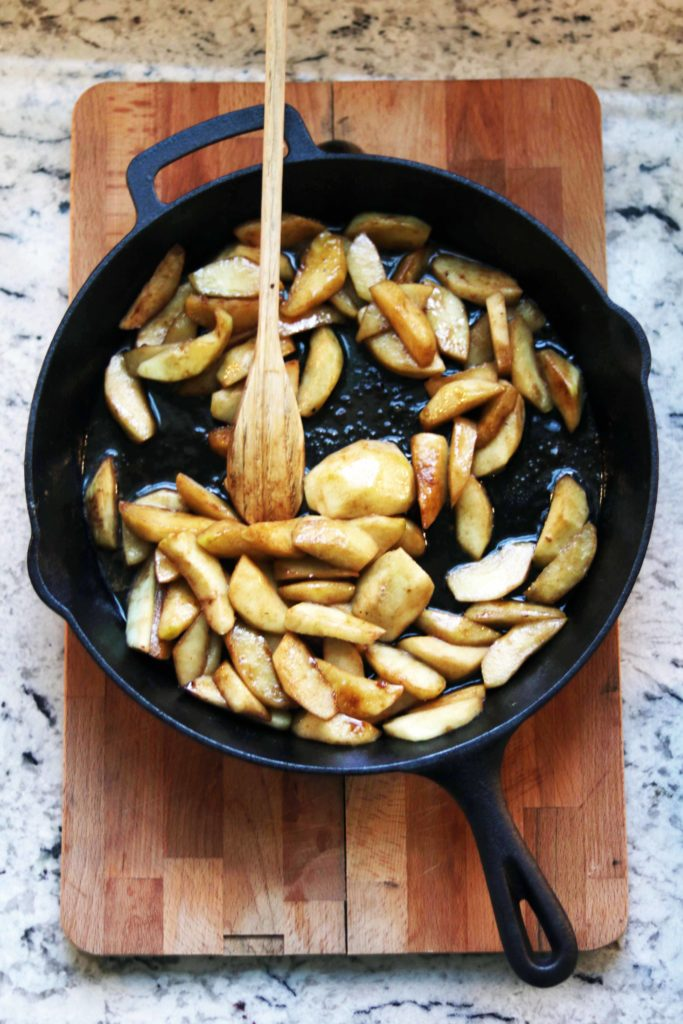 Hot fried cinnamon apples in a cast iron pan. Yum, so cozy for fall!
