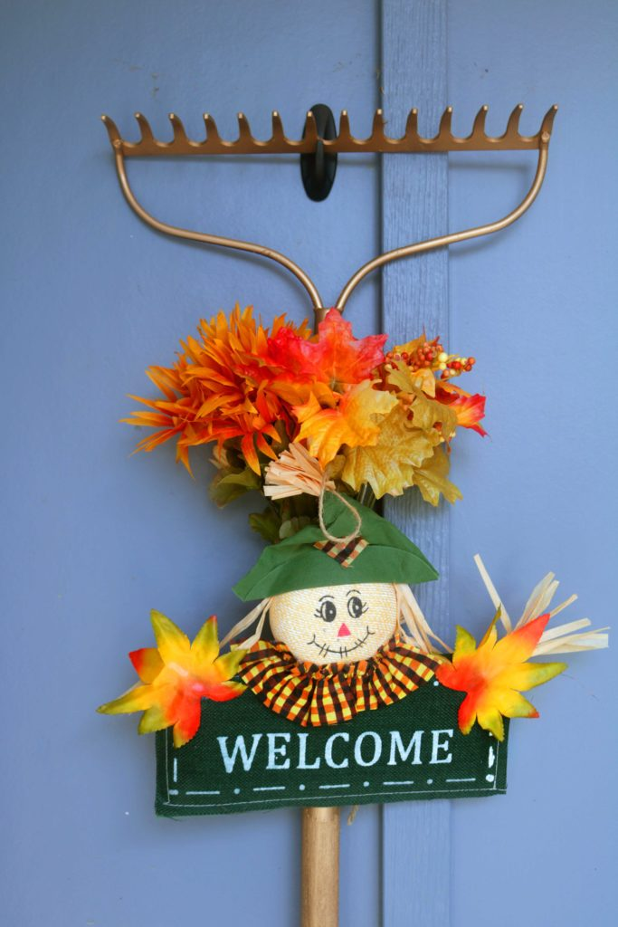 Upcycled yard tool turned into autumn decoration.