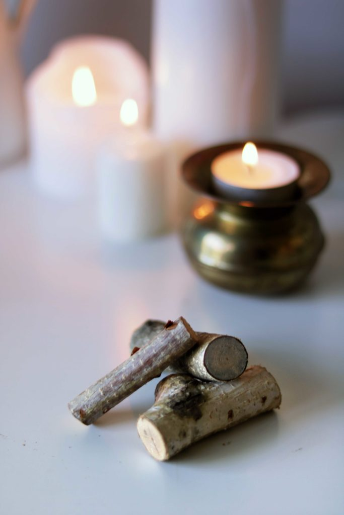 A tiny pile of wood symbolizes the winter hearth fire.