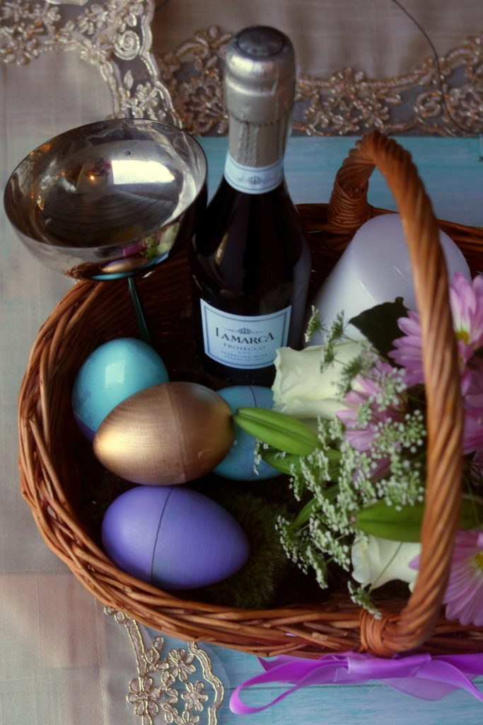 Prosecca, a vintage chalice, hand-painted wooden eggs and fresh flowers make this spring gift basket a beautiful way to celebrate the Equinox.