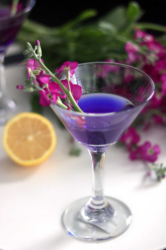 Purple fairy floral cocktail with natural peaflower color is perfect for Ostara, the spring equinox, Easter, a spring brunch or a bridal shower.