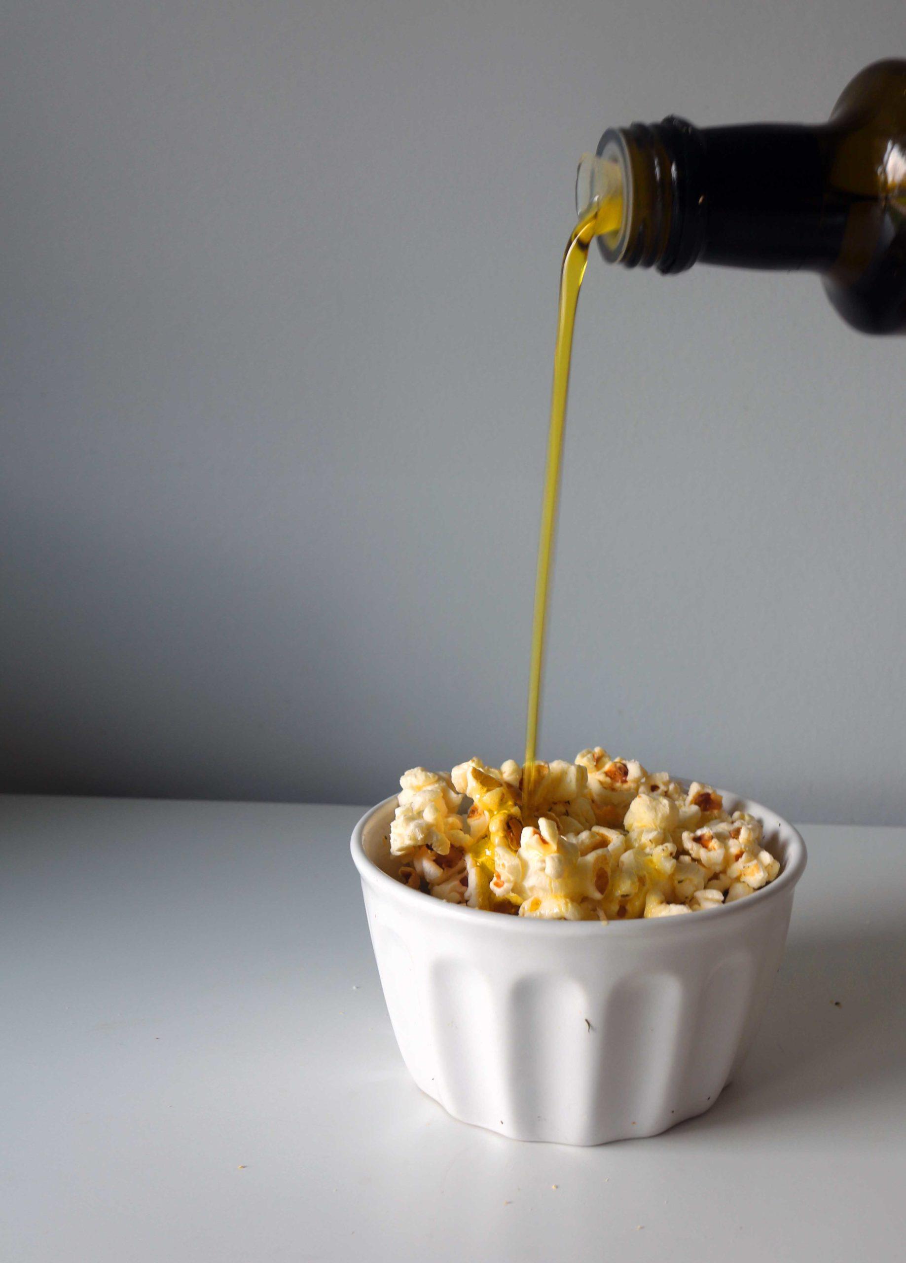 Olive oil poured on popcorn.