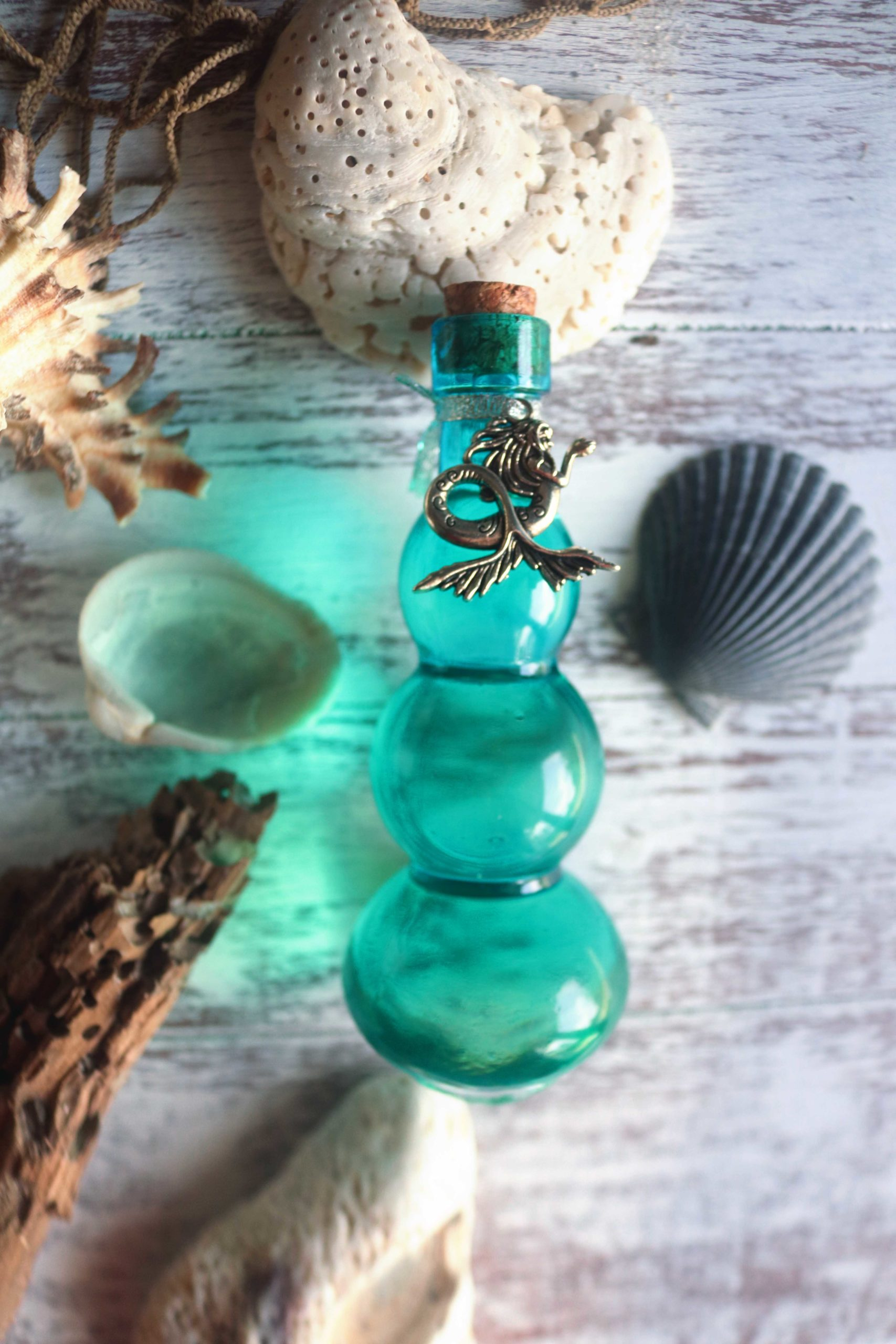 Sea witch ritual mermaid oil for evoking the Element of Water.