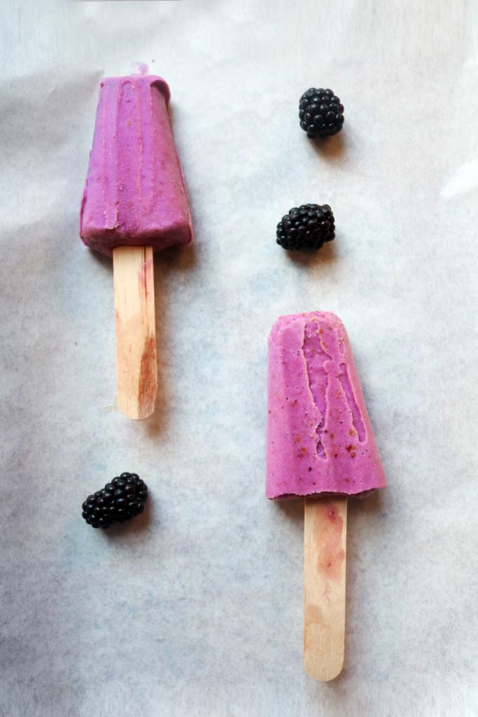 Easy, DIY blackberry moon milk ice pops with ashwagandha powder.