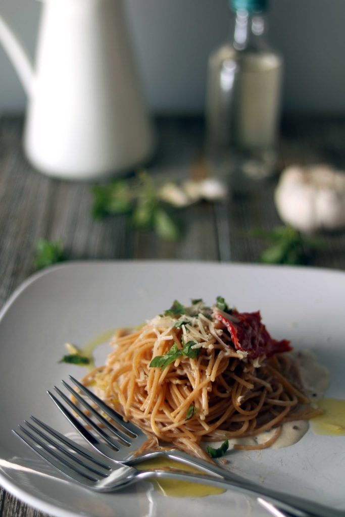 Imbolc creamy winter pasta with herbs and sundried tomatoes.
