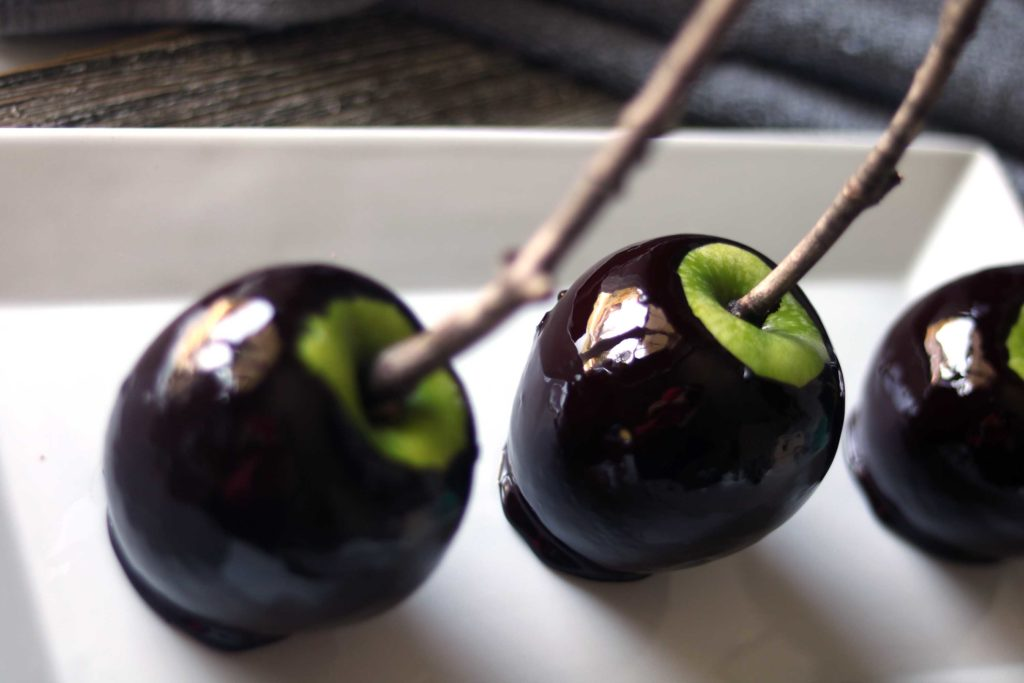 "Create a little magic at your Samhain, Halloween or Snow White themed party with these black magic ""poison"" candle apples. Super easy and fun to make."