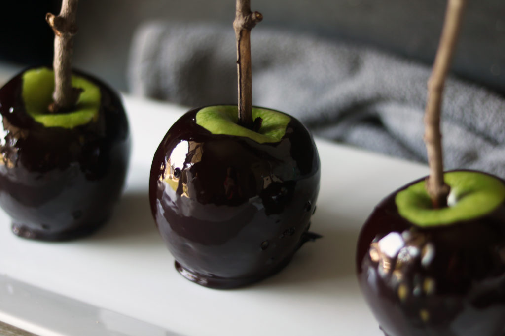 "A kitchen witch's recipe to make ""poison"" candy apples for Samhain or Halloween."
