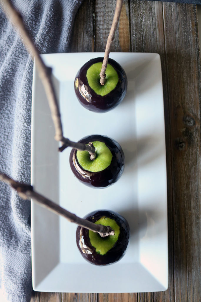 "A kitchen witch's recipe for ""poison"" black magic candy apples."