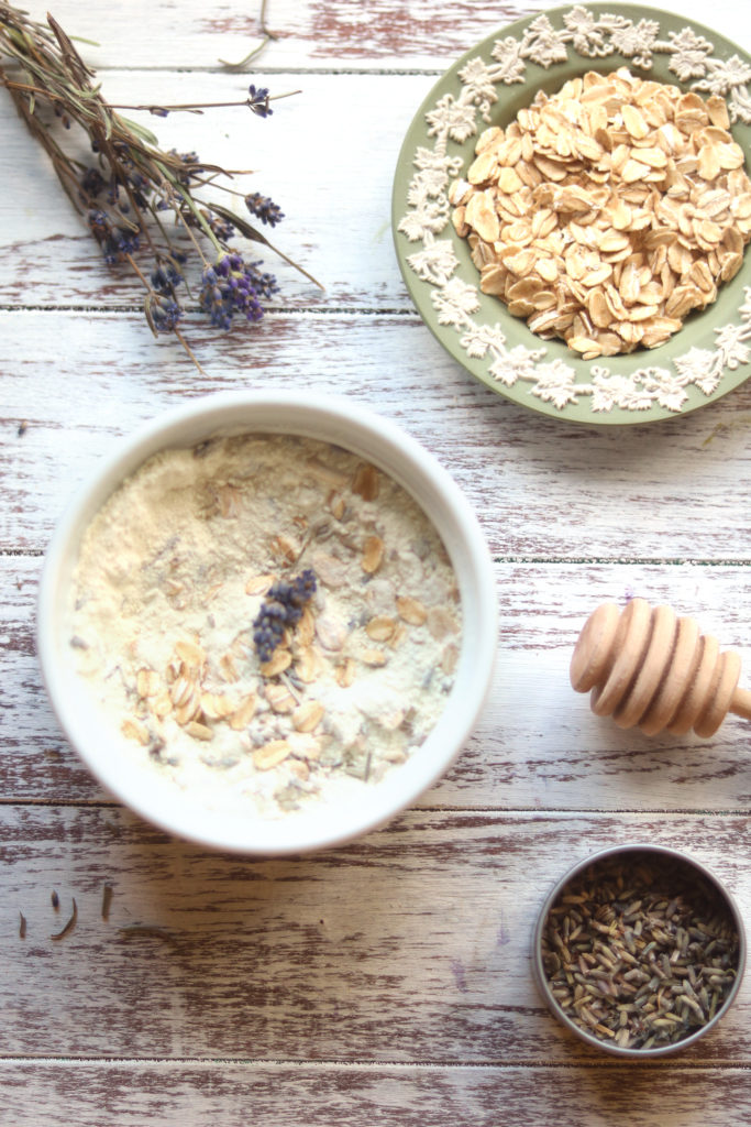 Ingredients for an oatmeal milk bath with lavender flower.