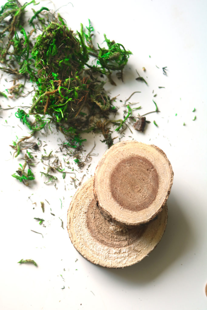 Using natural wood slices to make steps for a fairy door.