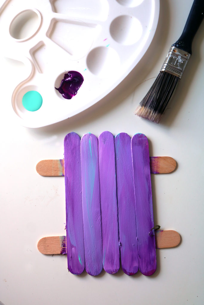 Painting a fairy door in layers.