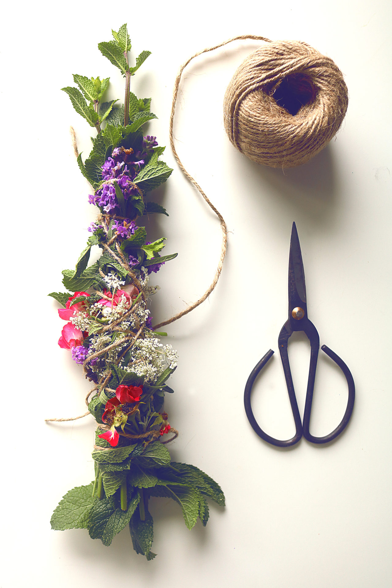 Have you seen all those beautiful incense wands on Etsy? They're super easy to make from garden herbs and flowers. Here's how.